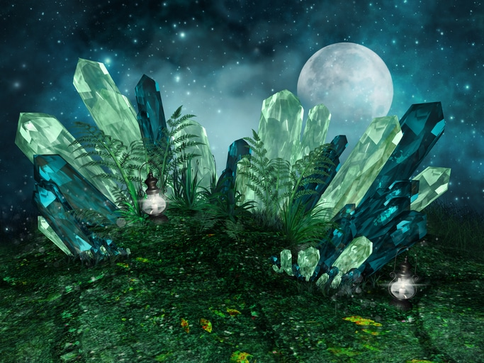 Blue and Green Crystals growing up in front of Moon