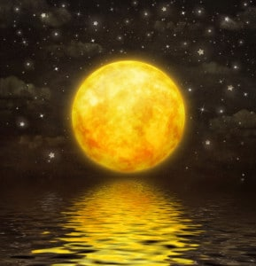 golden supermoon reflection on water